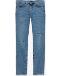 Saint Laurent - Jean skinny taille basse déchiré en denim bleu délavé taché noir - Lyst