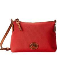 Dooney & Bourke - In Nylon New Slgs Styles Crossbody Pouchette (black W/ Tan Trim) Cross Body Handbags - Lyst