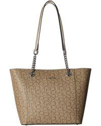 aa27285eb32f Calvin Klein - Monogram East/west Tote (sand Multi) Tote Handbags - Lyst