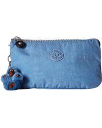 Kipling - Creativity Large Pouch (dream Blue) Clutch Handbags - Lyst