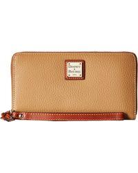 Dooney & Bourke - Pebble Leather Large Zip Around Wristlet (black/black) Wristlet Handbags - Lyst