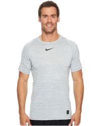 f1f04e50 Nike - Pro Heathered Short Sleeve Training Top (light Blue Fury/green Abyss/