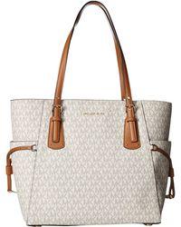 60f29b8a831a MICHAEL Michael Kors - Voyager East/west Signature Tote (vanilla) Tote  Handbags -