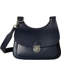 786051d53071 Lyst - Tory Burch Britten Clutch - Tory Navy in Blue