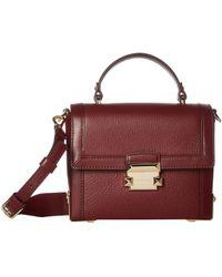 502c1d825097 Lyst - MICHAEL Michael Kors Jayne Pebbled Leather Trunk Bag in Purple