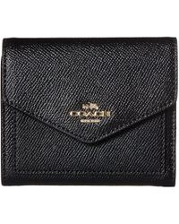 COACH - Black Wallet With Golden Metal Logo - Lyst