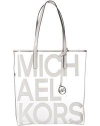 1b8315e152e2 ... wholesale michael michael kors the michael large clear tote lyst a0482  53c6a