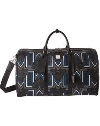 MCM - Traveler Gunta Medium Visetos Weekender (black) Weekender/overnight Luggage - Lyst