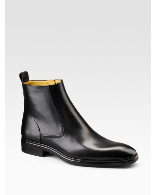 bally dress leather ankle boots in black for lyst