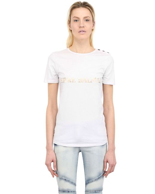 Balmain logo printed cotton t shirt in white save 31 lyst for Balmain white logo t shirt