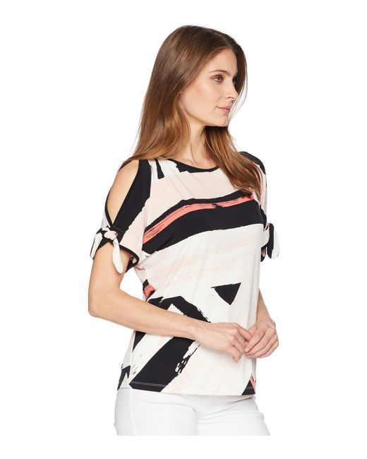55e2c98c60a7a Lyst - Ivanka Trump Printed Cold Shoulder Top With Open Hem in Black ...