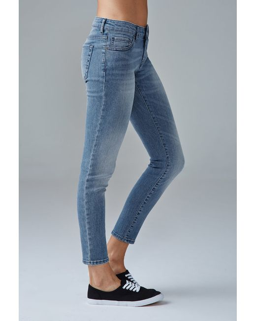 Forever 21 | Blue Sanded Wash Low-rise Skinny Jeans | Lyst