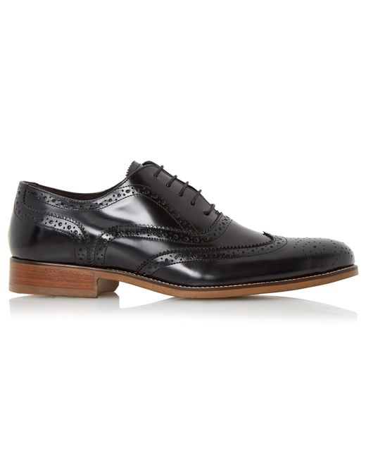 bertie rogue patent brogue shoes in black for lyst
