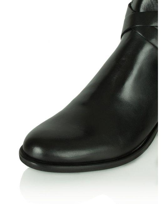 daniel idil knee length flat boots in black lyst