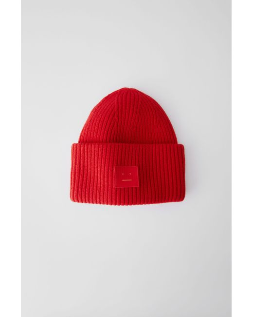 666fc6447ce Lyst - Acne Studios Pansy Face Tomato Red Ribbed Beanie Hat in Red ...