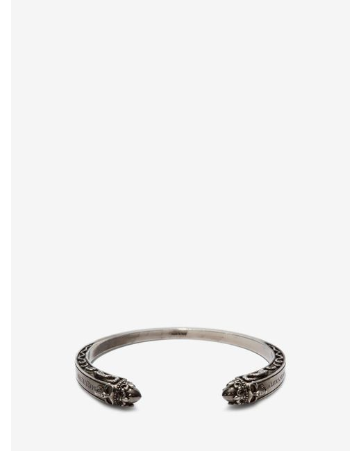 Alexander McQueen - Metallic Twin Skull Engraved Bracelet for Men - Lyst