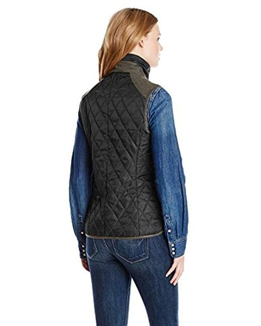 a89cea9e2e860 ... Vince Camuto - Black Quilted Vest With Suede Trim - Lyst