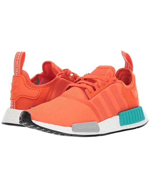 adidas originals mens nmd r1 running shoe blue night energy orange 4 ... e0c46e256