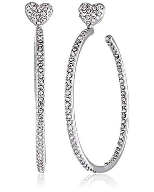 8c3a6a587b4325 Lyst - Betsey Johnson Medium Crystal Heart Hoop Earrings in Metallic ...
