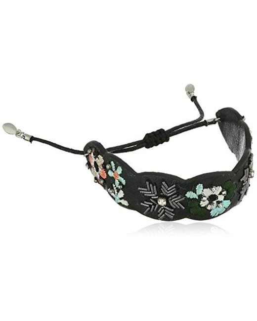 Rebecca Minkoff - Black Floral Embroidery Guitar Strap Pulley Bracelet - Lyst