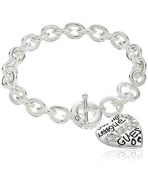 "Guess - Metallic ""basic Graffiti Logo Heart Toggle Charm Bracelet - Lyst"