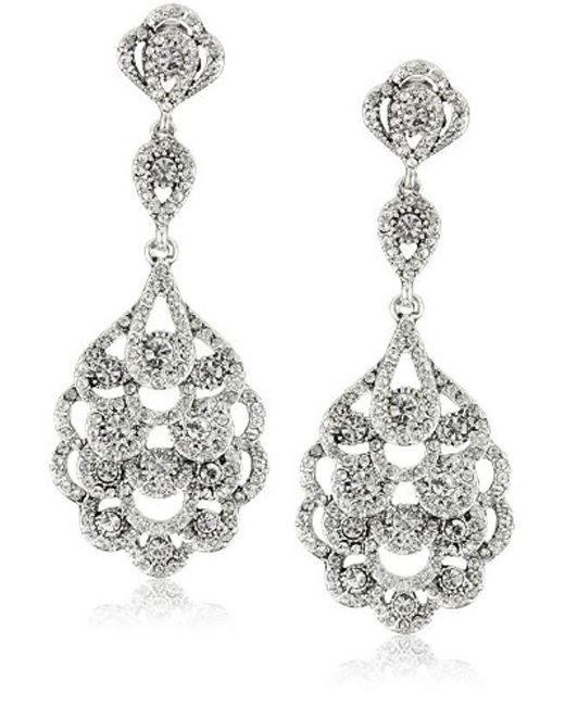 Nina - Metallic S Eiffel Earrings - Lyst