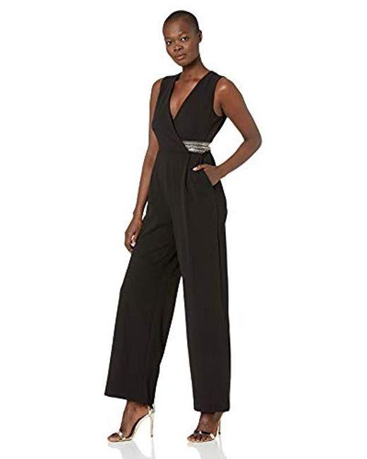 5b4b552b36 Calvin Klein - Black Sleeveless V Neck Jumpsuit With Embellished Waist -  Lyst ...