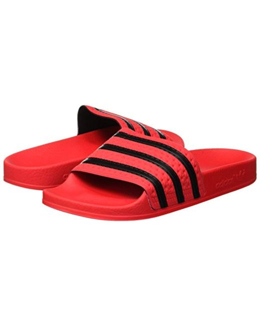 online store 6f59f b9228 ... Adidas - Red Adilette, Zapatos de Playa y Piscina para Hombre for Men -  Lyst ...