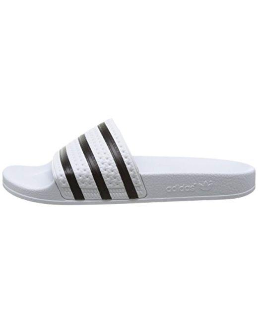 the best attitude 72394 c291c ... Adidas - White Adilette, Zapatos de Playa y Piscina Unisex Adulto for  Men - Lyst ...