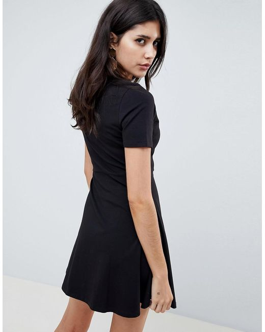 bdf5a6aaa73c ... ASOS - Black Mini Skater Dress With Button Front - Lyst