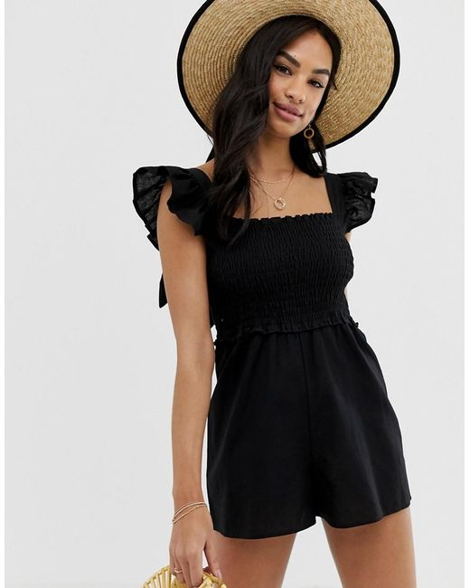 d87b3d0454 ASOS - Black Shirred Playsuit With Frill Sleeve - Lyst ...