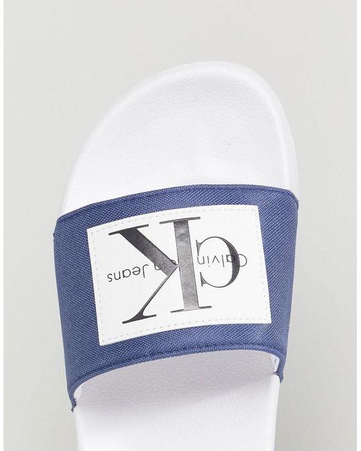 Calvin Klein Curseurs Vitaux Logo En Bleu - Bleu WO7e1N