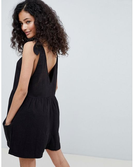 487b4c29a6a4 ... ASOS - Black Smock Playsuit With Tie Shoulder - Lyst