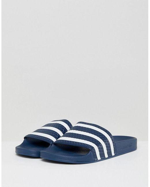 the latest 8c9e0 e8997 Adidas Originals - Blue Adilette Sliders In Navy 288022 for Men - Lyst ...