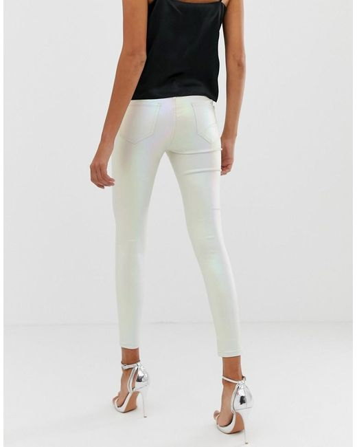 5b463c47e14611 ... Lipsy - Pink Coated Skinny Jeans In Pearlescent Cream - Lyst