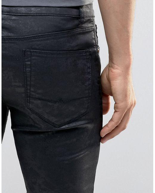 asos super skinny jeans in black coated in black for men lyst. Black Bedroom Furniture Sets. Home Design Ideas
