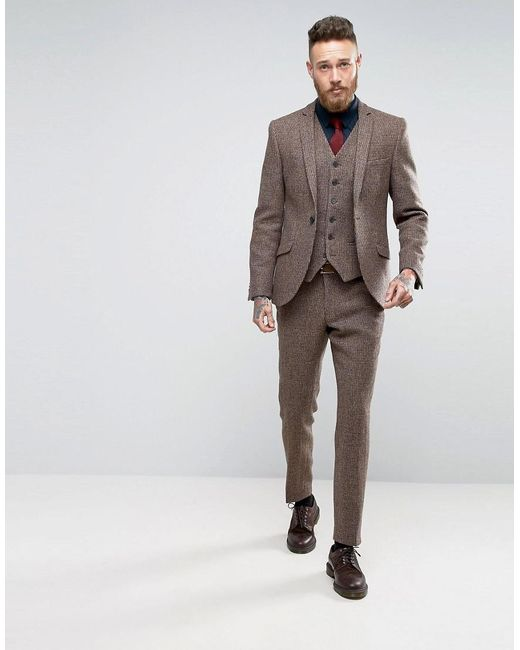 """Don't be intimidated by the emphasis on """"slim."""" While slim fit suit jackets have a narrower cut and higher armholes to project a trim look, they can be worn by a variety of men. Accurate measurements are essential with any suit, but especially so with apparel tailored to contour to the body. This suit forgoes excess fabric in the jacket."""