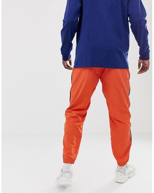 280fe32f0 adidas Originals Woven 3 Stripe Joggers In Orange in Orange for Men ...