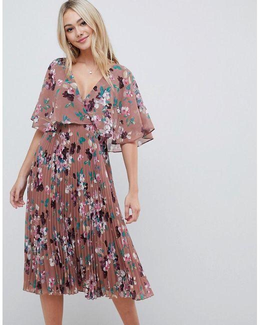 96261e3d8 Robe mi-longue à manches évasées avec jupe plissée et imprimé fleuri ASOS  en coloris ...
