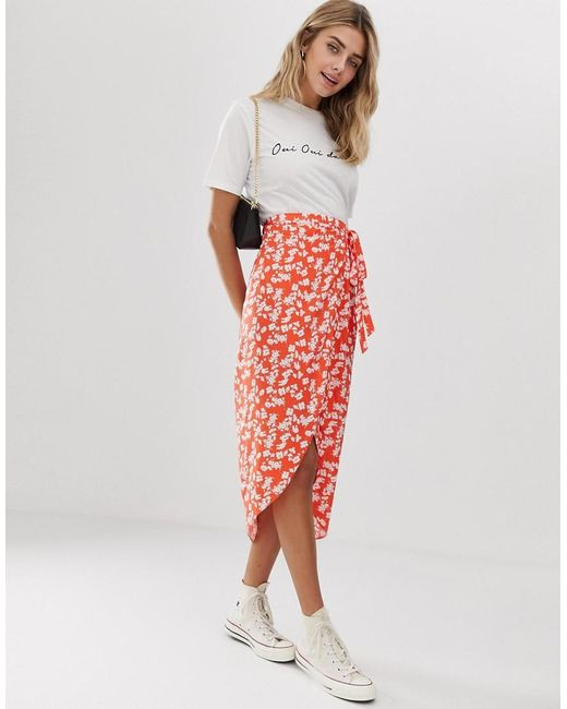 fc9e786eb6bb ASOS - Red Ditsy Floral Wrap Midi Skirt - Lyst ...