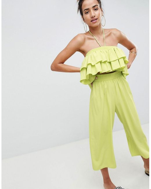 328180c7c0e ASOS - Green Ruffle Bandeau Jumpsuit With Cut Out Waist Detail - Lyst ...
