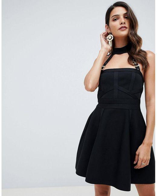 ab73963b00cd ASOS - Black Bandage Skater Mini Dress With Halter Neck Buckle Straps - Lyst  ...