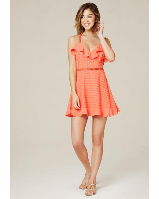 Bebe | Orange Ruffled Cross Back Dress | Lyst