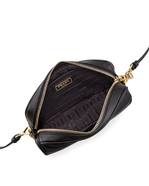 5f7c61c49e5353 ... best price prada black small saffiano leather camera crossbody bag lyst  3f1da 1587d