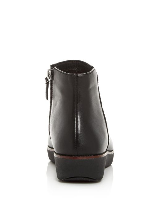 477fa4502c39b Lyst - Fitflop ZIGGY Zip Mid Boots in Black - Save 31%