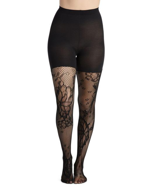 6255acd6fcb08 Spanx Floral Fishnet Shaping Tights in Black - Save 41% - Lyst