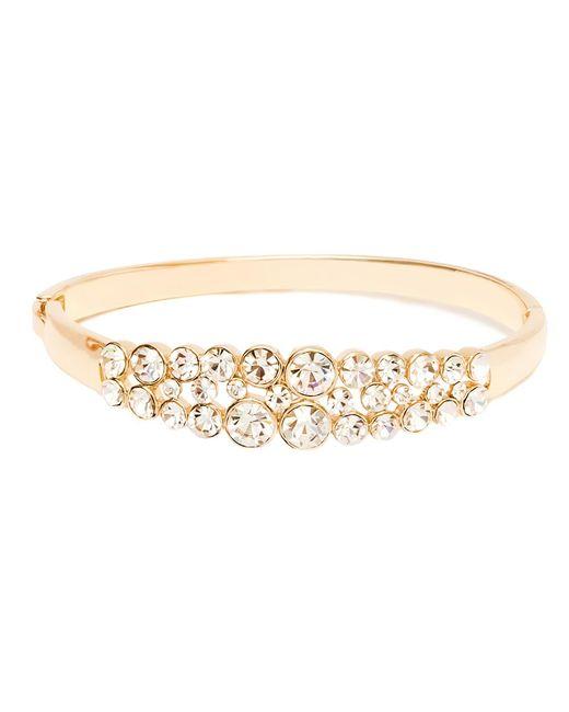 Peermont | Metallic Gold And White Swarovski Elements Circle Cutout Bow Bangle | Lyst