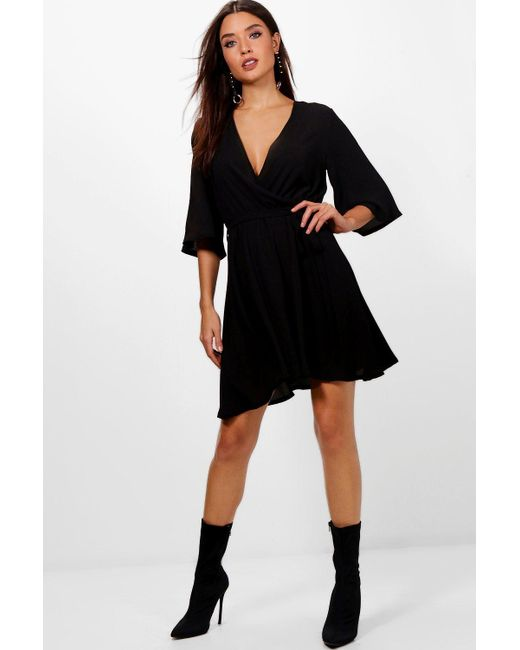 682036f7c9430 Boohoo - Black Wrap Front Belted Wide Sleeve Dress - Lyst ...