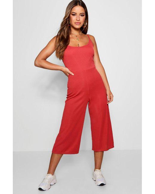 2cf607543e Boohoo - Red Petite Rib Strappy Culotte Jumpsuit - Lyst ...