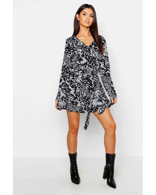 2e3640f0bcee Boohoo - Black Mixed Animal Print Wrap Front Mini Dress - Lyst ...